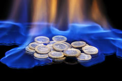 Coins on fire Royalty Free Stock Images