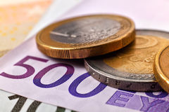 Coins and five hundred euro banknotes Stock Photos