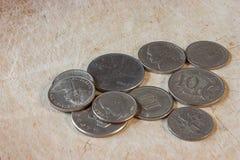 Coins on the floor Stock Photos