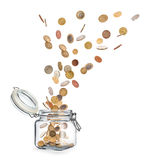 Coins fly out of glass jars Royalty Free Stock Photos