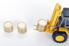 Coins and forklift Royalty Free Stock Photo