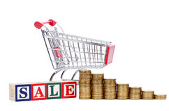 Coins in the form of the diagramme, shopping cart Royalty Free Stock Images
