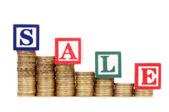 Coins in form of the diagramme and word SALE Royalty Free Stock Images