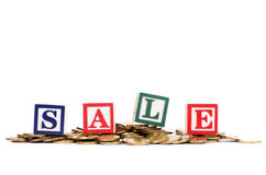 Coins in form of the diagramme and word SALE Royalty Free Stock Photography