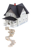 Coins in front of house architectural model, isola Royalty Free Stock Photos