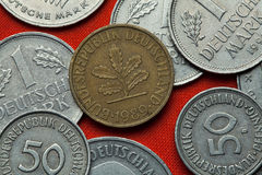 Coins of Germany. Oak sprig depicted in the German 10 pfennig coin Royalty Free Stock Photo