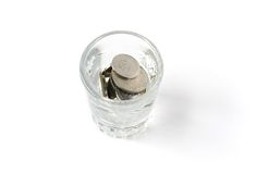 Coins in glass Stock Photos