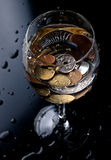 Coins in a glass Stock Photos