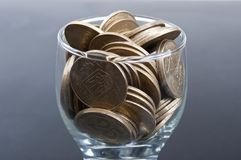 Coins in a glass Royalty Free Stock Photography