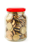 Coins in glass can Stock Photos