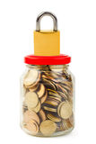 Coins in glass can and lock Royalty Free Stock Image
