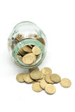Coins and Glass Jar. On White Background Stock Photo