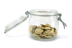 Coins in Glass Jar Stock Photography
