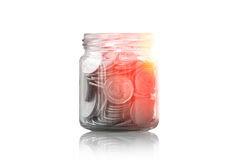 Coins in a glass jar against ,savings coins - Investment And Interest Concept saving money concept Royalty Free Stock Image