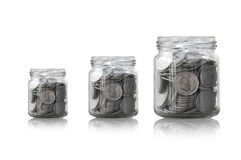 Coins in a glass jar against ,savings coins - Investment And Interest Concept saving money concept Royalty Free Stock Photos