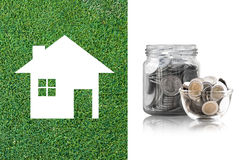 Coins in a glass jar of buying a new house - saving money for future concept Royalty Free Stock Image