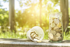 coins in a glass jar Stock Images