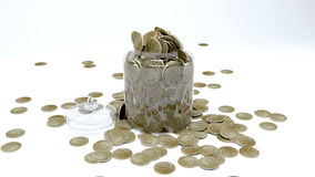 Coins in a glass jar Royalty Free Stock Photos
