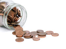 Coins in a glass jar. Dropped. Royalty Free Stock Photography
