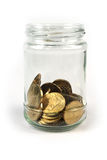 Coins in glass jar on isolated Royalty Free Stock Photography