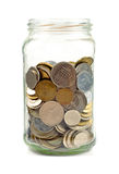 Coins in glass jar royalty free stock image