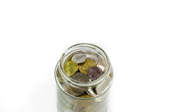 Coins in glass jar isolated on white background Stock Images