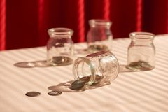 Coins in glass jar. Money savings concept.  royalty free stock image
