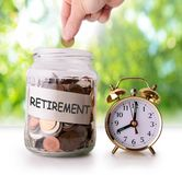 Coins in glass jar for retirement Royalty Free Stock Images
