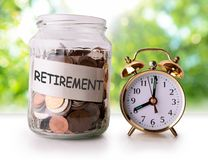 Coins in glass jar for retirement Stock Photography
