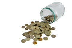 Coins in a glass jar Royalty Free Stock Image