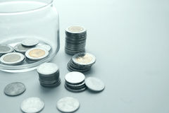 Coins and glass jar. Stock Photo