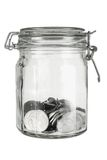 Coins in Glass Jar Stock Image