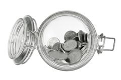 Coins in Glass Jar Royalty Free Stock Photos