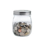 Coins in glass jars on a white background. Royalty Free Stock Photos