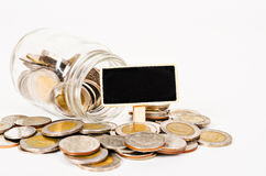 Coins in glass money jar. Stock Image