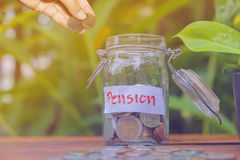 Coins in glass money jar with pension label Royalty Free Stock Photo