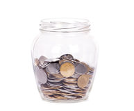 Coins in glass money jar Stock Photography