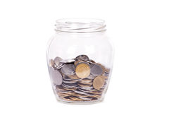 Coins in glass money jar Royalty Free Stock Image