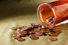 Coins in a glass tube Royalty Free Stock Image