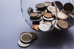 Coins and glass Royalty Free Stock Photography
