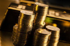 Coins and gold bars. Gold bars, money and financial concept Stock Photo