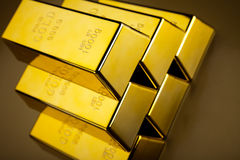 Coins and gold bars, ambient financial concept.  Royalty Free Stock Images