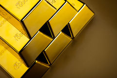 Coins and gold bars, ambient financial concept.  Royalty Free Stock Photo
