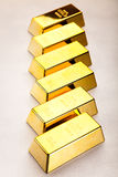 Coins and gold bars, ambient financial concept.  Royalty Free Stock Photos