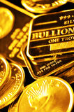 Coins of Gold and Bars for Wealth and Riches Stock Photo