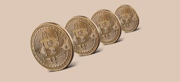 Coins gold bitcoin virtual crypto currency. Coins bitcoin standing on a beige background. Conceptual image for worldwide cryptocurrency and digital payment royalty free stock image