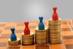 Coins Gold Pile with Pawns graph of success concept Stock Photos