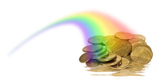 Coins of Gold in a rainbow Stock Photography