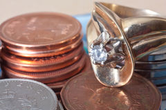 Coins and golden ring Stock Image