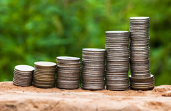 Coins graph. On green background (it is photographed outdoors Royalty Free Stock Image